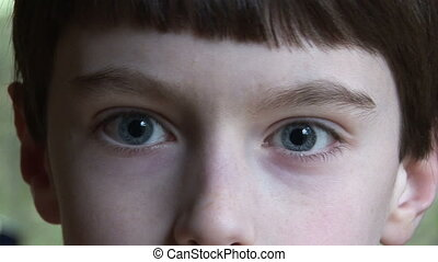 Boy (10 Yrs) crossing eyes and laughing, Thousand Oaks, California, close up