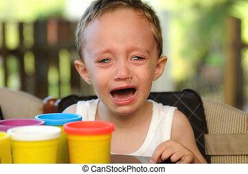 Boy crying in a summer school