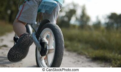 Boy Cycling a Run Bike