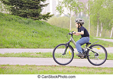 Boy cycling in park