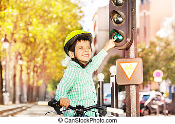 Boy cycling on his bike and learning traffic rules - Smiling...