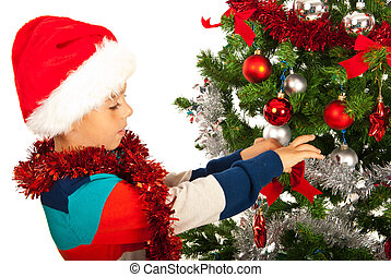 Boy decorate Christmas tree