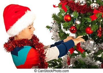 Boy decorate Christmas tree
