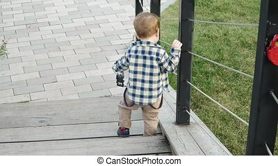 Boy descends the wooden stairs