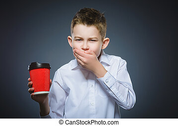 boy does not want to drink coffee. The child does not like the beverage