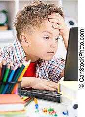 Boy doing homework - Portrait of despairing adolescent boy...