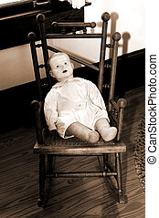 Boy Doll in a Chair in Sepia