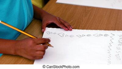 Boy doodling in white notepad - Little boy doodling in white...