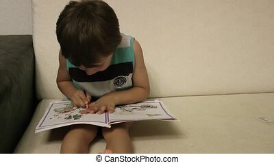 Boy Drawing on Book
