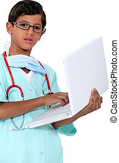 Boy dressed as a doctor