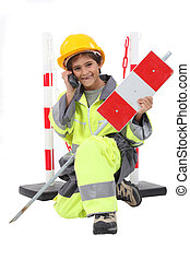 boy dressed as a road worker