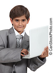 Boy dressed as businessman