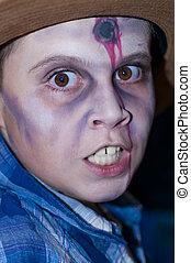 Boy dressed as zombie head shot