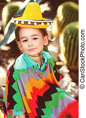 Boy dressed in Mexican costume against the background of a...
