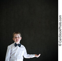 Boy dressed up as businessman holding anything on cupped hand