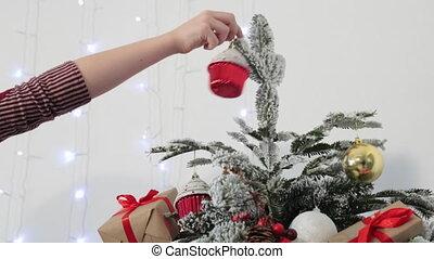 Boy dresses up Christmas tree