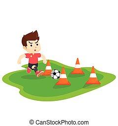 Boy dribbling ball