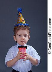 Boy drinking juice