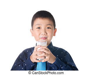Boy drinking milk with milk mustache holding glass of milk isolated on white background