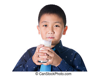 Boy drinking milk with milk mustache holding glass of milk isolated