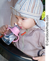 boy drinking water from bottle