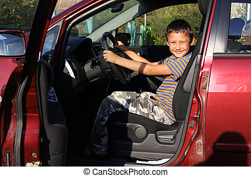boy driver in car