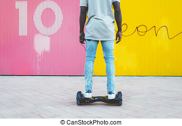 boy driving a hoverboard or self-balancing scooter