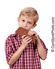 boy eat chocolate on white