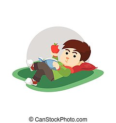Boy eating apple and read a book