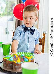 Boy Eating Birthday Cake