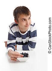Boy eating blueberries