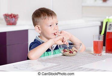 Boy Eating Bowl of Cereal for Breakfast