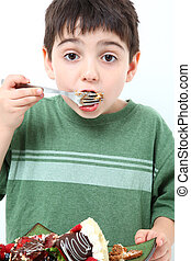 Boy Eating Cheesecake