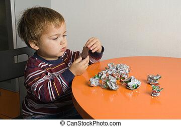 Boy eating chocolates