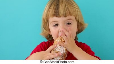 Boy eating croissant