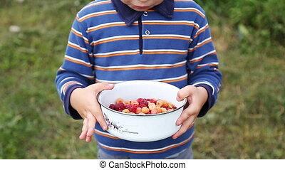 Boy eating fresh berries - Young Boy Eating fresh...