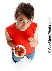 Boy eating lollies