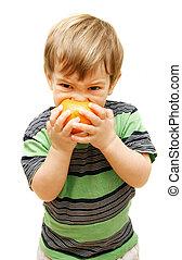 boy eating orange over white