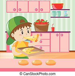 Boy eating pizza in kitchen