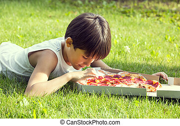boy eating pizza