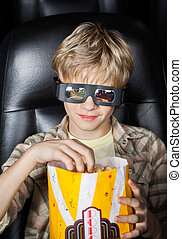 Boy Eating Popcorn While Watching 3D Movie