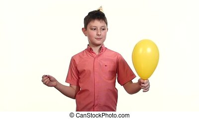 boy eats balloon with a needle and frightening explosion slow motion