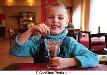 boy eats chocolate dessert 2