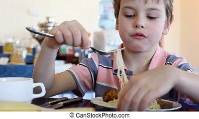 Boy eats noodle