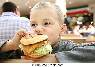 boy eats the sandwich