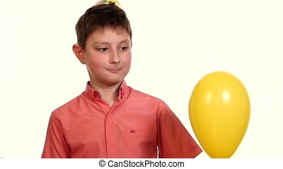 boy eats yellow balloon with a needle and frightening...