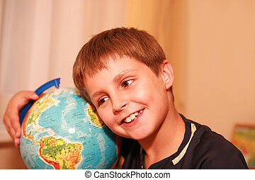 boy embracing globe of world