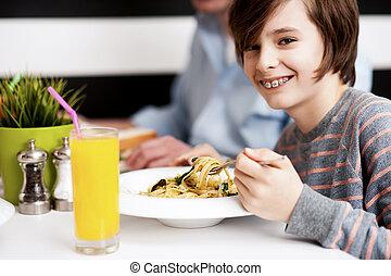 Boy enjoying food and fresh juice