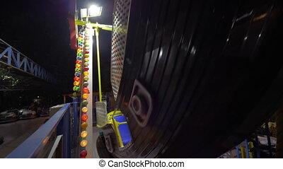Boy enjoying pirate boat ride at fun fair - Slow motion shot...