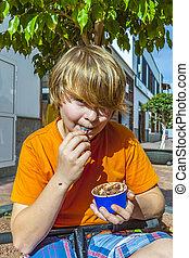 boy enjoys icecream